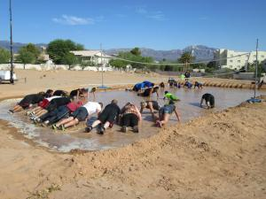 Participants gather inside the water-filled volleyball court to see who can do the most pushups. Photo by Stephanie Frehner.