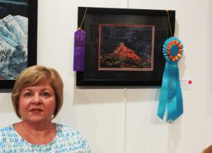 Vanessa Temple won two top awards for her painting, Big Sedona Sky.