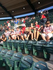 The scouts and leaders relax and enjoy an Angels baseball game during their Summer Camp trip. Submitted photo.