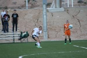 Bulldog Abbie Barnum #22 watches he shot head for goal Wednesday night during the Dawgs 5-0 win over the Mojave Rattlers. Barnum had four goals for her evenings work. Photo by Lou Martin
