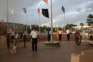 Veterans Honor Guard posts the Colors at the Veterans Memorial Service Saturday morning. Photo by Lou Martin