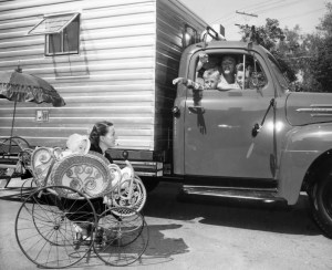 3. Chris, Robert and Jim Mitchum in the cab of their camper in 1954 heading off on camping trip as mother Dorothy and sister Trini look on. Photo provided by Chris Mitchum
