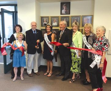 On Tuesday, August 12, 2014, Ms. Senior Mesquite 2014, Donna Watson was joined by past queens, Jean Watkins, Claudia Nicholas, Mary Jane Vandeweghe, Margaret Parrott, Nila Lilienthal, Mayor Al Litman and Councilman Geno Withelder to dedicate the Queens' portrait wall at Mesquite City Hall. Photo courtesy of Delaney Studio.