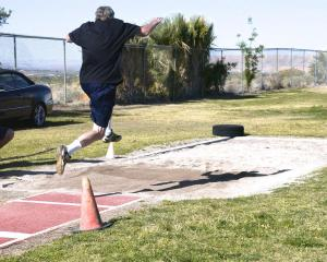 Ron Damschen of San Diego does the Men's Long Jump competition. Photo by Burton Weast