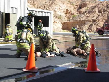 Three members of the fire department attempt to revive the three victims, although unsuccessful. Photo by Stephanie Frehner.