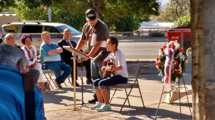 Hughes Middle School 7th Grader Cecelia Gomez performed a song that she and her father had written and dedicated to her uncle who served several tours in recent wars. The video of her performance can be seen on the MLN's Facebook page. Photo by Stephanie Frehner.