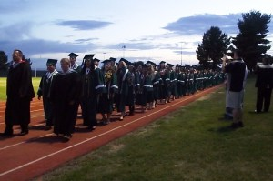 The graduation procession of the 126 Virgin Valley High School seniors is charged with excitement, hope and plenty of encouragement from the standing room only crowd of supporters of this 2015 graduating class. Photo by Teri Nehrenz.