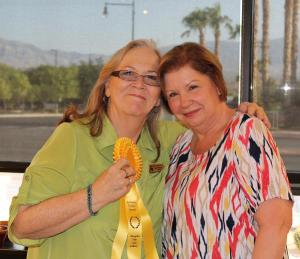 Jean Wiensch, left, won the Sponsor's Choice award presented by Gerri Chasko, right, who represented the Eureka Casino Resort, the August Abstract Art exhibit sponsor. Photo by Barbara Ellestad.