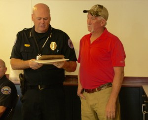 Richmond receives plaque honoring his service from Chief Tanner. Photo by Burton Weast.