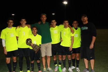 Bulldog seniors and coaches hoist Rivals Cup after a 7-0 win over Pirates 7-0. Featured from left to right, John Pollock, Emmanuel Navarro, David Cabrera with cup, head coach Mike Pletzke, Moises Medina, Jay Gomez, Orlando Diaz and assistant coach Sean FitzSimons. Photo by Lou Martin.