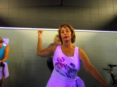 """Phyllis Litman shows how """"Spinning"""" is not just for weight control or toning your legs.  Here Litman shows the muscle tone in her arms from an up and down movement they call """"Jumping"""" and riding the cycle while standing on the pedals. Litman says, """"Spinning"""" has enormous cardio benefits as well. Photo by Teri Nehrenz."""