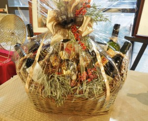 A luscious wine and cheese basket will go to a lucky raffle winner in the Mesquite Fine Arts Gallery. The raffle helps fund scholarships for local high school students pursuing an education in the arts. Photo by Linda Faas.