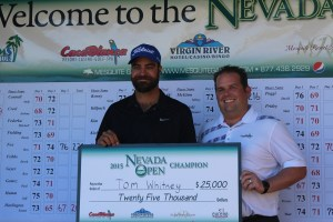 Tom Whitney, left, took home the largest purse in the history of the Nevada Open played at the Palms and CasaBlanca golf courses in Mesquite. He shot 14 under par in three rounds. He accepted his $25,000 winnings from Christian Adderson, Tournament Director for Mesquite Gaming. Photo by Barbara Ellestad.