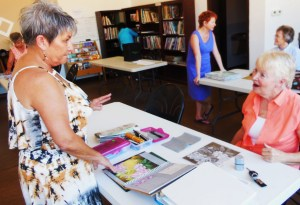 Bunny Wiseman, left, gives personalized help to each of her drawing students. Photo by Linda Faas.