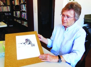 Drawing student Donna Newcom shows her current project in Bunny Wiseman's class. Photo by Linda Fass.