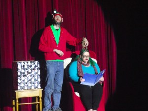 Matt McDonald, left, and Jenna Grubb wrote several scripts for skits for the Sixth Annual Community Christmas Concert held at the Mesquite Community Theatre on Dec. 4 and 5.  McDonald and Grubb perform a skit about 'The Night Before Christmas.' Photo by Teri Nehrenz.