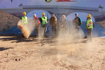 Members of Mesquite City Council and Mayor Al Litman toss ceremonial shovels of dirt at the groundbreaking ceremony for the new I-15 Exit 118 interchange on Wednesday, Dec. 2. George Gault, MRBI President, left, and RSC General Manager for Do It Best Corporation Wendy Kenny, far right, participate. Photo by Barbara Ellestad.