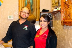 : Los Lupes Manager, Pepe Quirarte, left, and Hostess/Cashier Laura Aguilera help keep the Mesquite location staffed and customers well taken care of while owner, Maria Martinez, commutes daily to oversee the operations in their newly opened Las Vegas location . Photo by Teri Nehrenz.