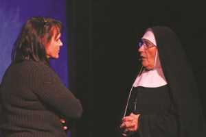 Teri Nehrenz, left, plays psychiatrist Dr. Livingstone in the Virgin Valley Theatre Group's current production of 'Agnes of God' as Mother Superior, portrayed by Marilyn (Mike) Brenner tries to help find the truth about the death of a newborn baby. Photo by Barbara Ellestad.