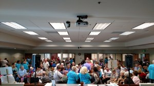 Even before the noon caucus time, Mesquite City Hall Council Chamber was bursting at the seams as over 500 new and returning democrats showed up to help their candidate take the Nevada Caucus for 2016. Photo by Stephanie Frehner.