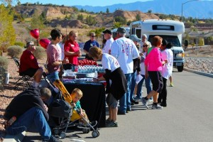Mesquite residents who participated in the Heart walk were treated to apples, water and trail mix handed out by Patty Holden, Mesa View Hospital's CEO, and Rob Fuller Director of Marketing. Photo by Teri Nehrenz.