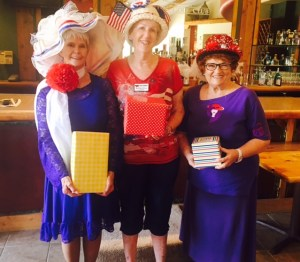 Winners of the Patriotic Red Hat contest are from left, Bonnie Mikkelsen, Joyce Stafford and Valerie Thompson. Photo submitted.