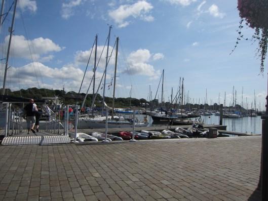 Sailboats moored at the Lymington quay.