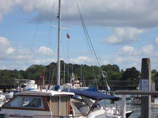 "Boat flying a ""courtesy flag""."