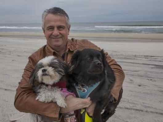 vince-stango-with-dogs-on-beach