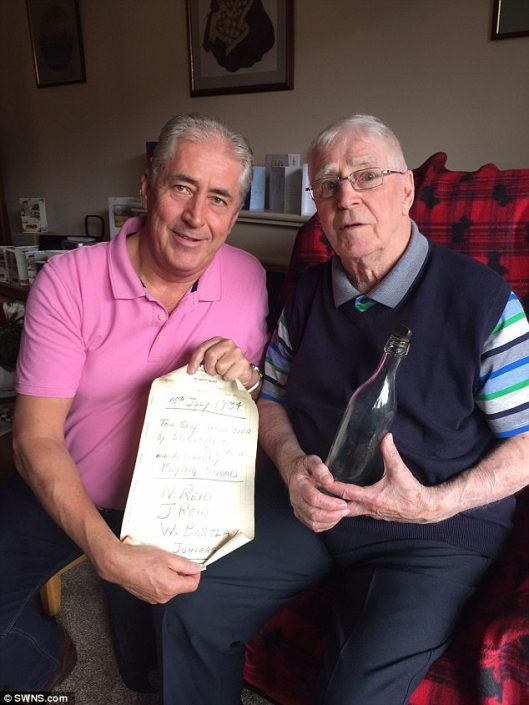 Laurence Reid with 83 year old message in a bottle from his father.