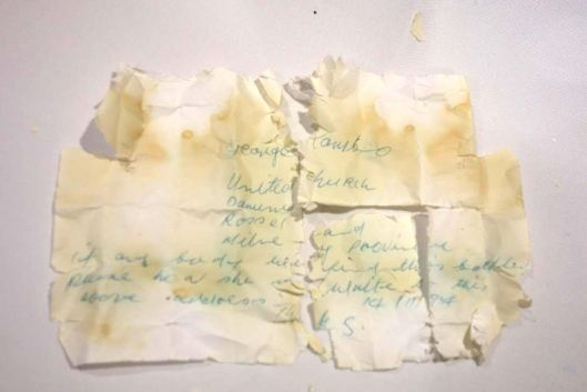 Amelia Earhart Message in a Bottle: Close up of the message in a bottle found by Tom Jagger