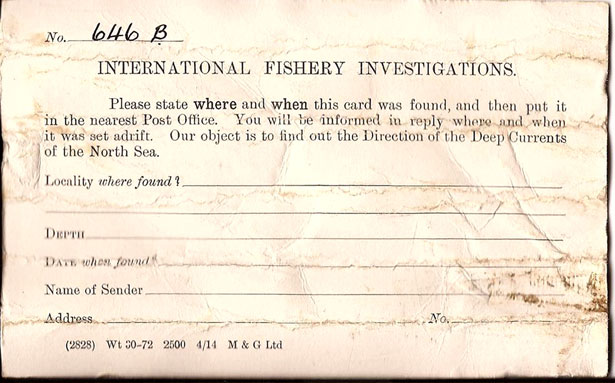 Andrew Leaper 98 year old message in a bottle front of post card