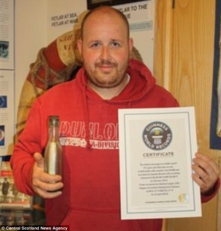 98 year old message in a bottle - Andrew Leaper with his bottle and Guinness Records Certificate.