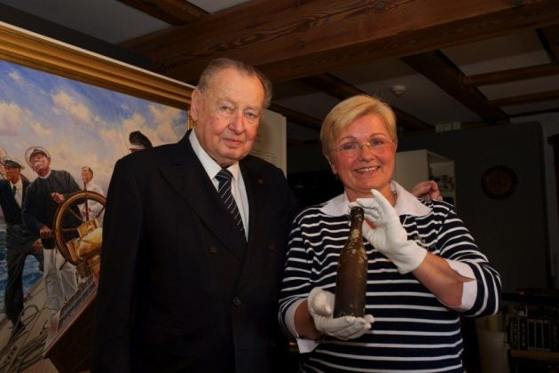101 year old message in a bottle: Angela Erdmann holds her grandfather's message in a bottle