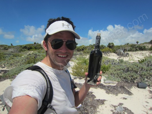 Clint Buffington with Message in a bottle from Lily of Ft. Lauderdale on the beach