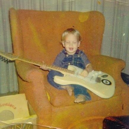 Jordan Zevon as a kid with guitar for Too Late to Be Saved Lyrics and Meaning analysis