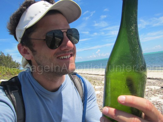 Clint Buffington with Kleenex Message in a Bottle on the Beach