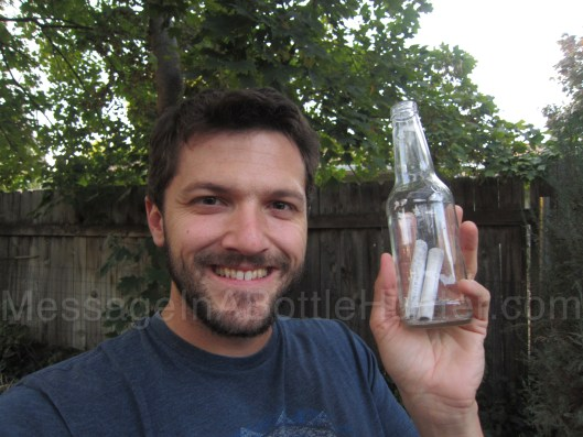 Clint Buffington with Charleston Student's message in a bottle science project before removing the message.