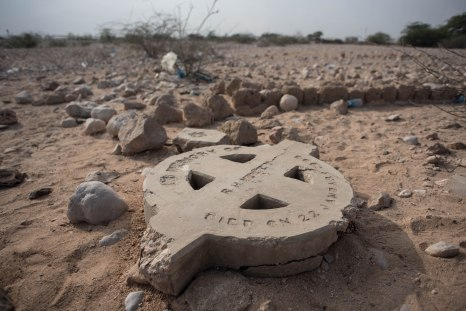 A broken headstone of a grave of a British colonialist on the outskirts of Berbera.