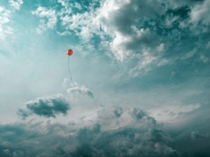 Lone balloon floating in the sky