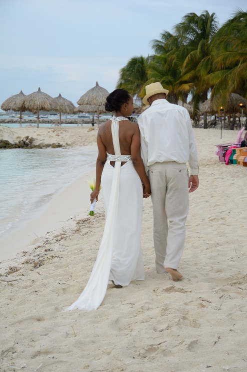 Walking along the beach in Aruba on my wedding day