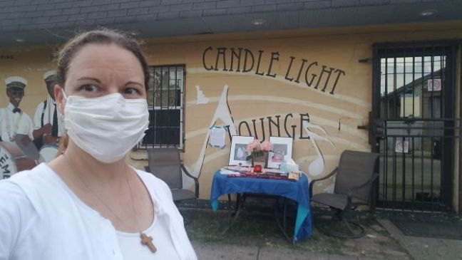 woman-white-surgical-mask-building-candle-light-lounge