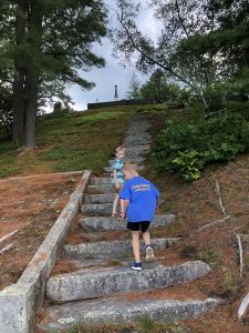 two-boys-stone-steps-trees