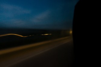 on the way home; in the bus; through the window glass: long-exposure