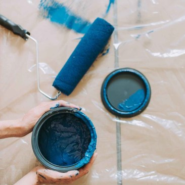 blue paint beside blue paint roller