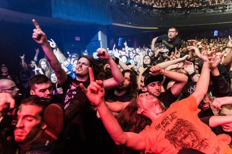 people crowd surfing during the behemoth show at Mtelus in montreal