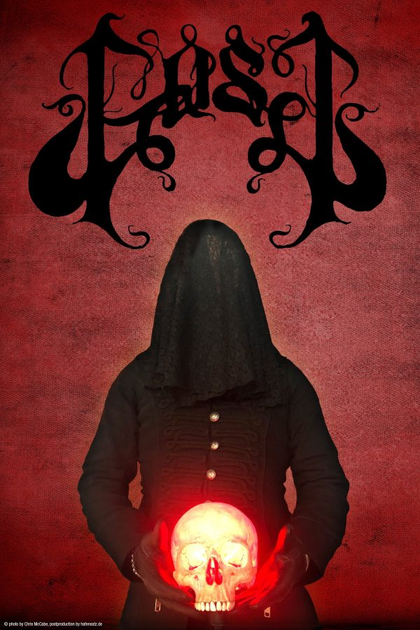 Image of Baalberith of GosT. He is dressed in a black tunic with large gold buttons and wears a black hood over his head, like a shroud. His leather gloved hand hold a glowing skull. The background is a dark red colour with a texture like crushed velvet. Above him is the GosT logo which is black and virtually unreadable due to it having fancy curls everywhere.