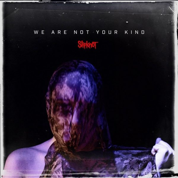 Slipknot We Are Not Your Kind Album cover image. Mainly black image featuring a person trying to pull a shroud off their head.