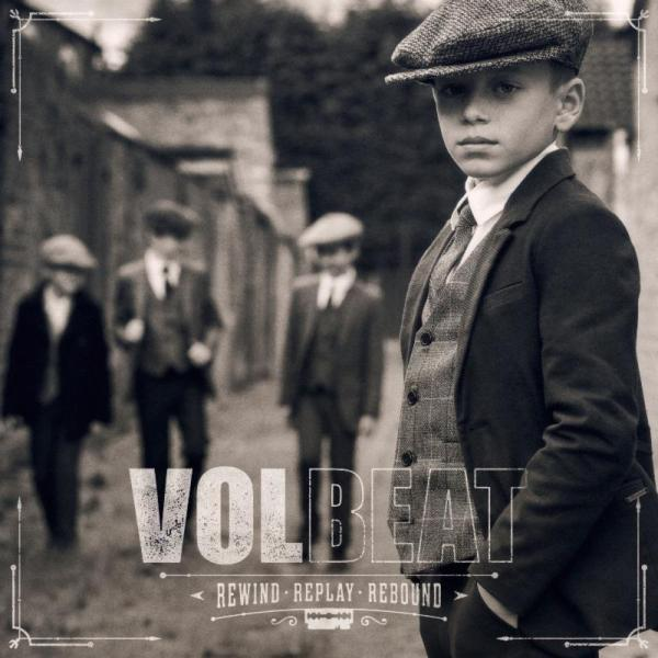 Volbeat album cover, Rewind, Replay, Rebound. Children in 1930's clothes, stood on cobbled street,black and white image.