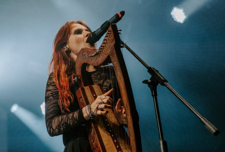 Anna Murphy of Eluveitie sings while playing the harp live at Bloodstock on the Friday night of the festival